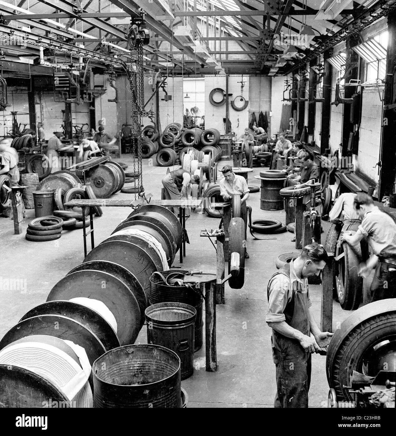 England, 1950s. A photograph by J Allan Cash of British factory workers producing motorcar tyres. As can be seen - Stock Image