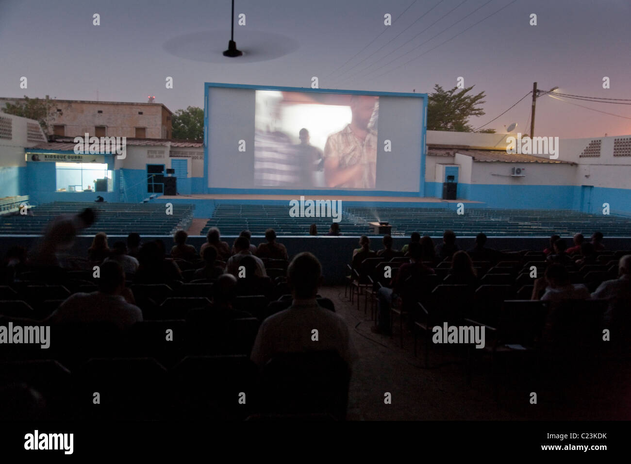 A screening at the Ciné Ourbi open-air cinema during FESPACO film festival in Ouagadougou, Burkina Faso - Stock Image