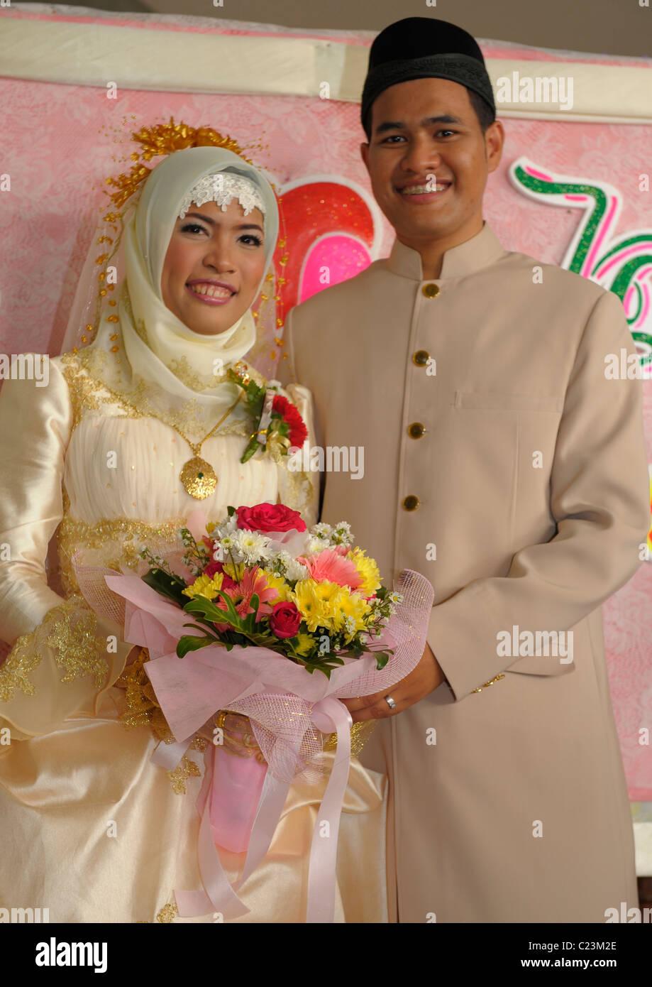 bride and groom , islamic wedding , muslim community , bangkok, thailand - Stock Image
