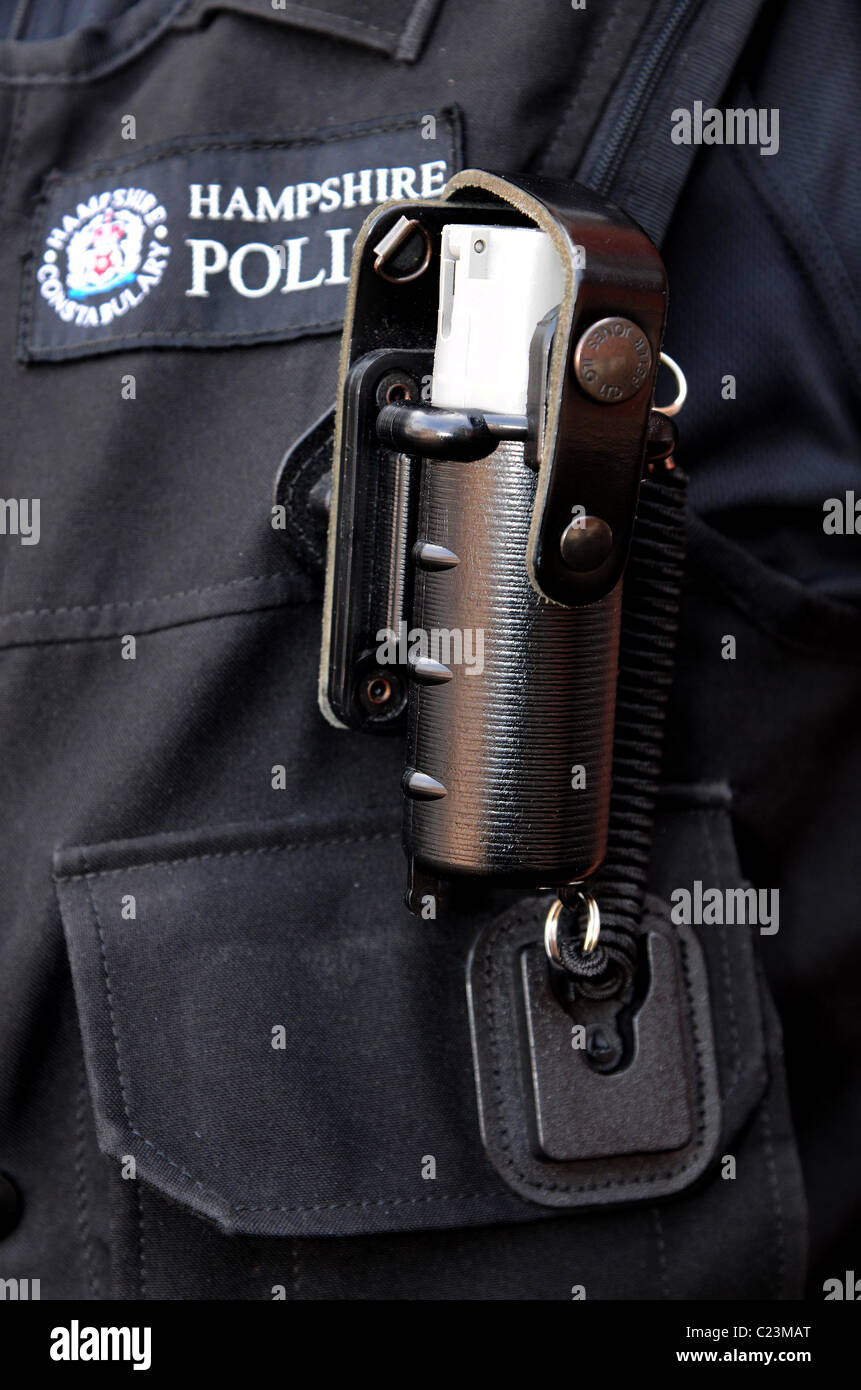 Detail of the CS gas spray carried by British police officers on their body armour or utility belts. Stock Photo