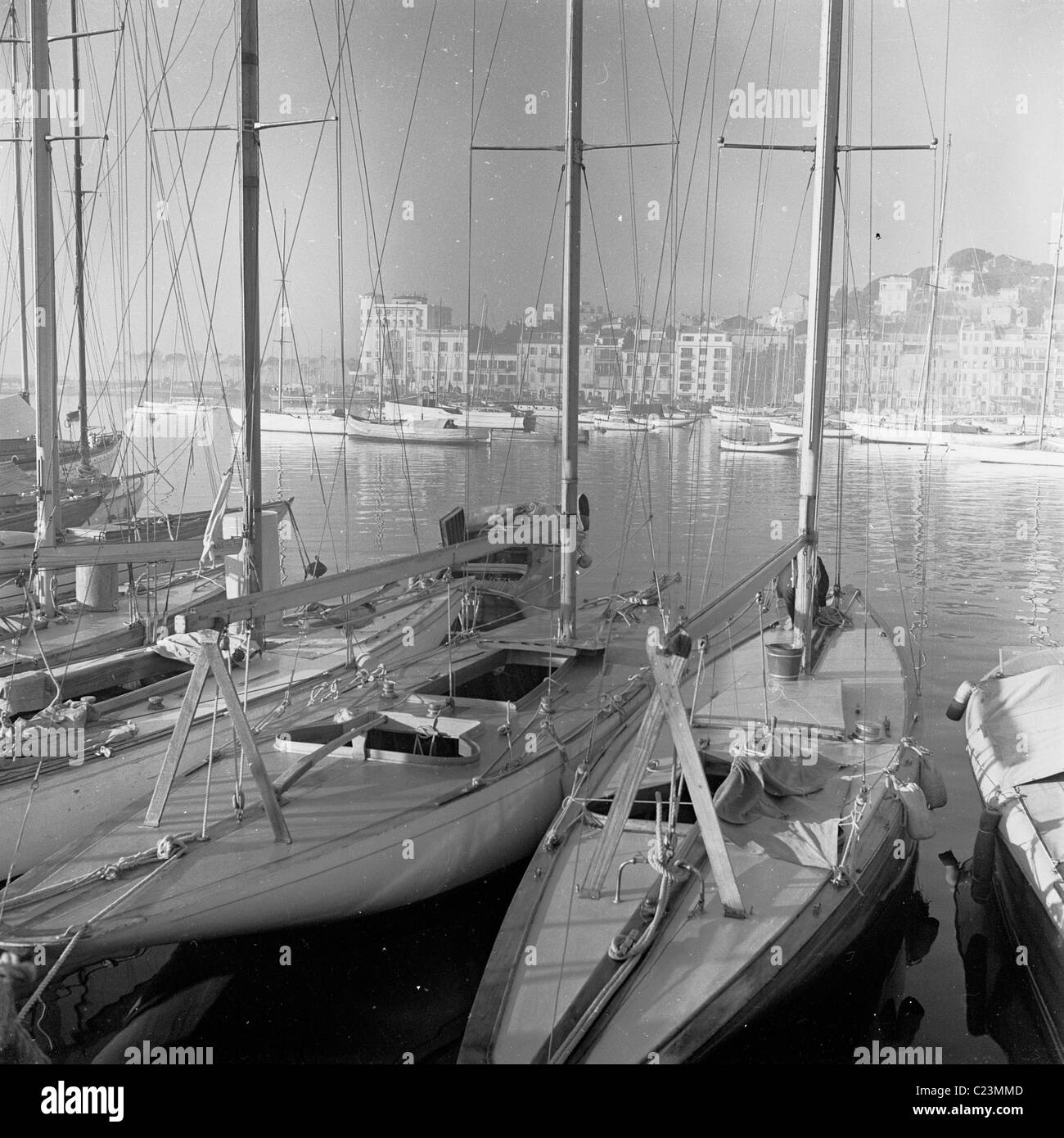 1950s. France. Sailing boats moored in the harbour at Cannes, in this historical photograph by J Allan Cash. - Stock Image