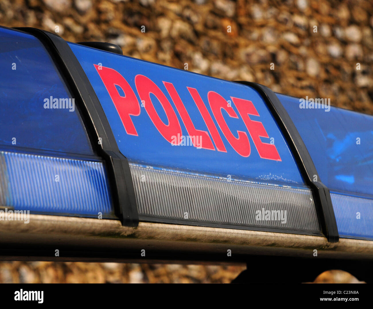 Detail of red on blue police lights and marking. - Stock Image