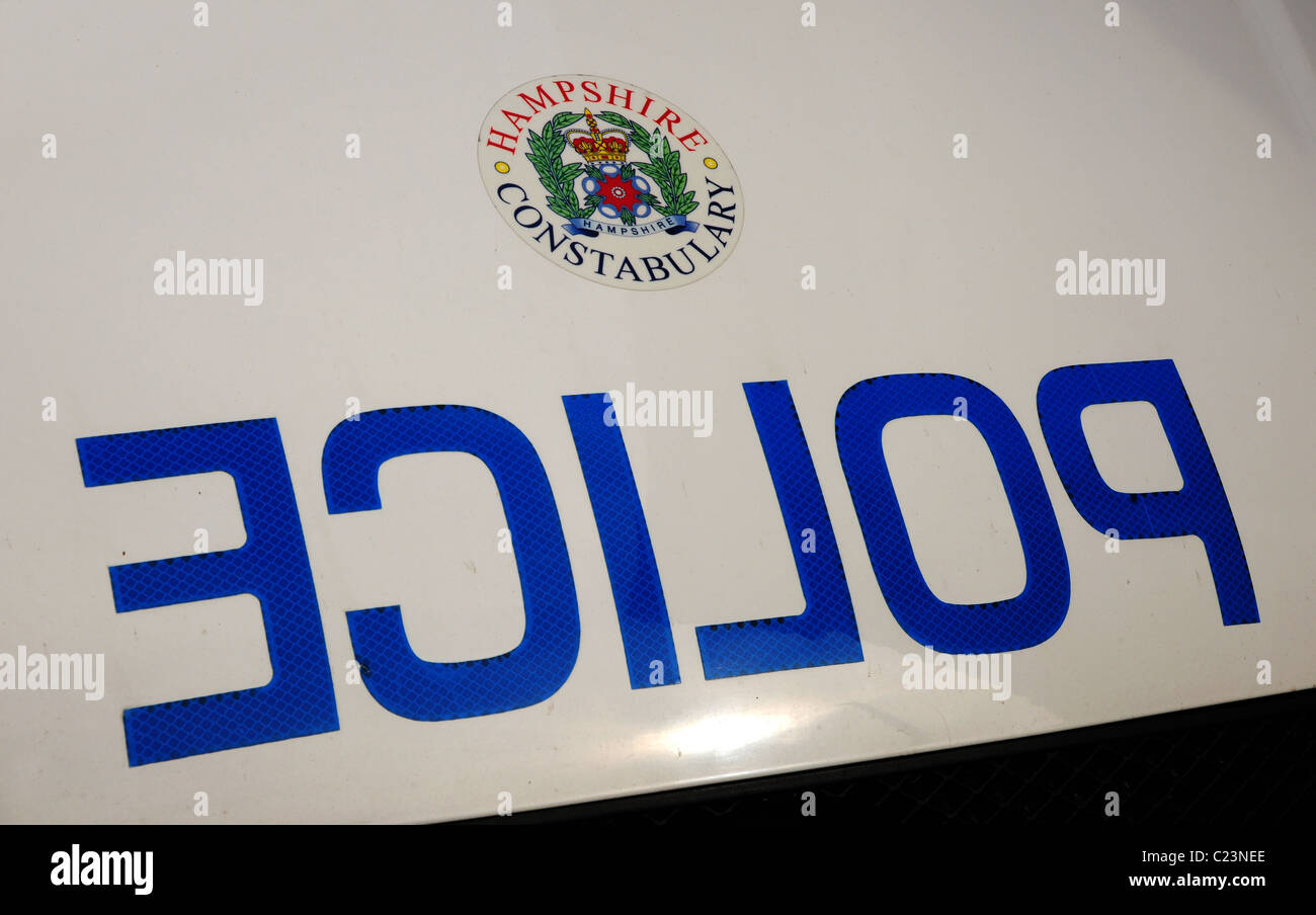 POLICE logo in reverse on the front of a patrol car - Stock Image