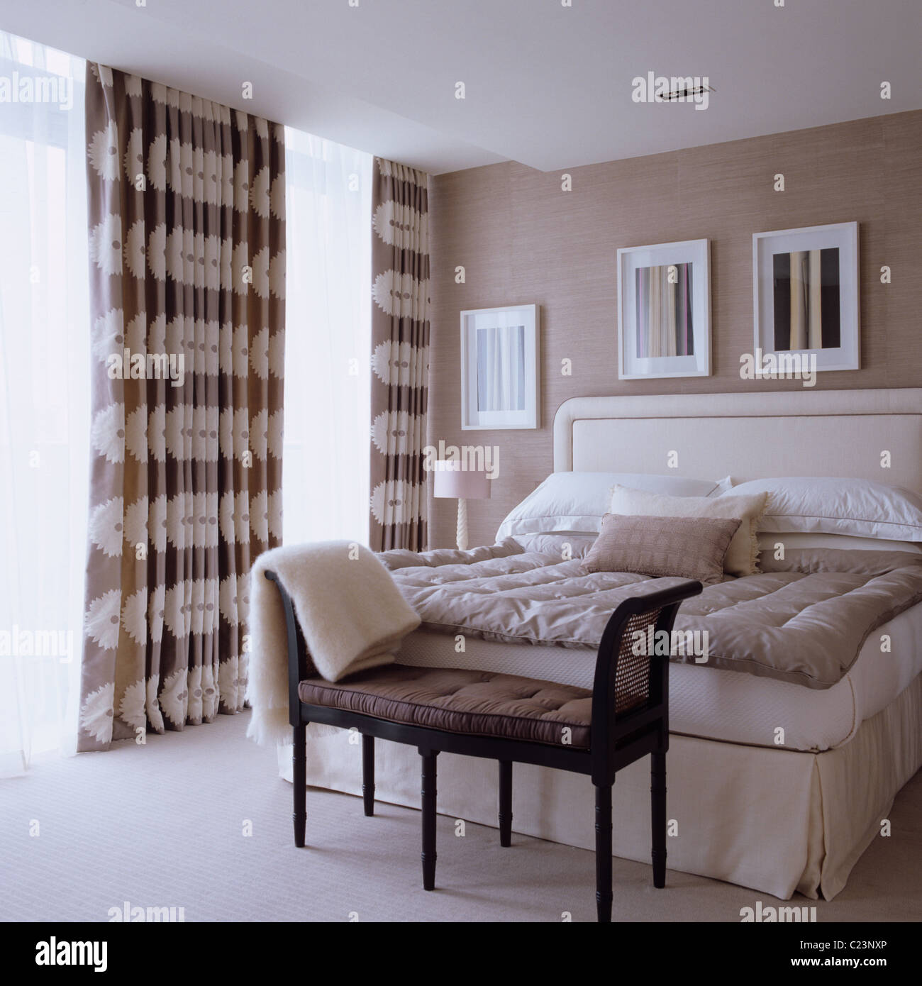 Double Bed In Bedroom Decorated In Neutral Tones With Interior Design Stock Photo Alamy