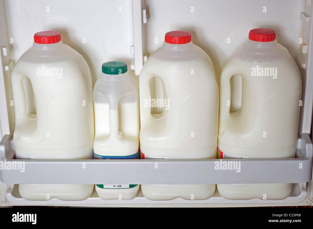Milk in fridge, UK. - Stock Image