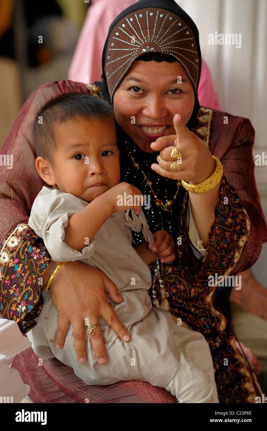 mother with her son, islamic wedding , muslim community , bangkok, Thailand - Stock Image