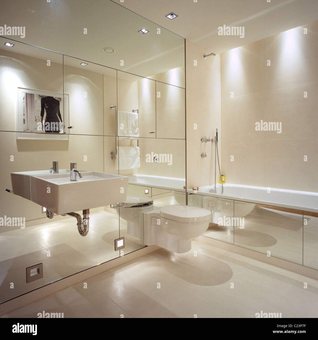 Mirrored wall in contemporary bathroom with interior design by Stock ...