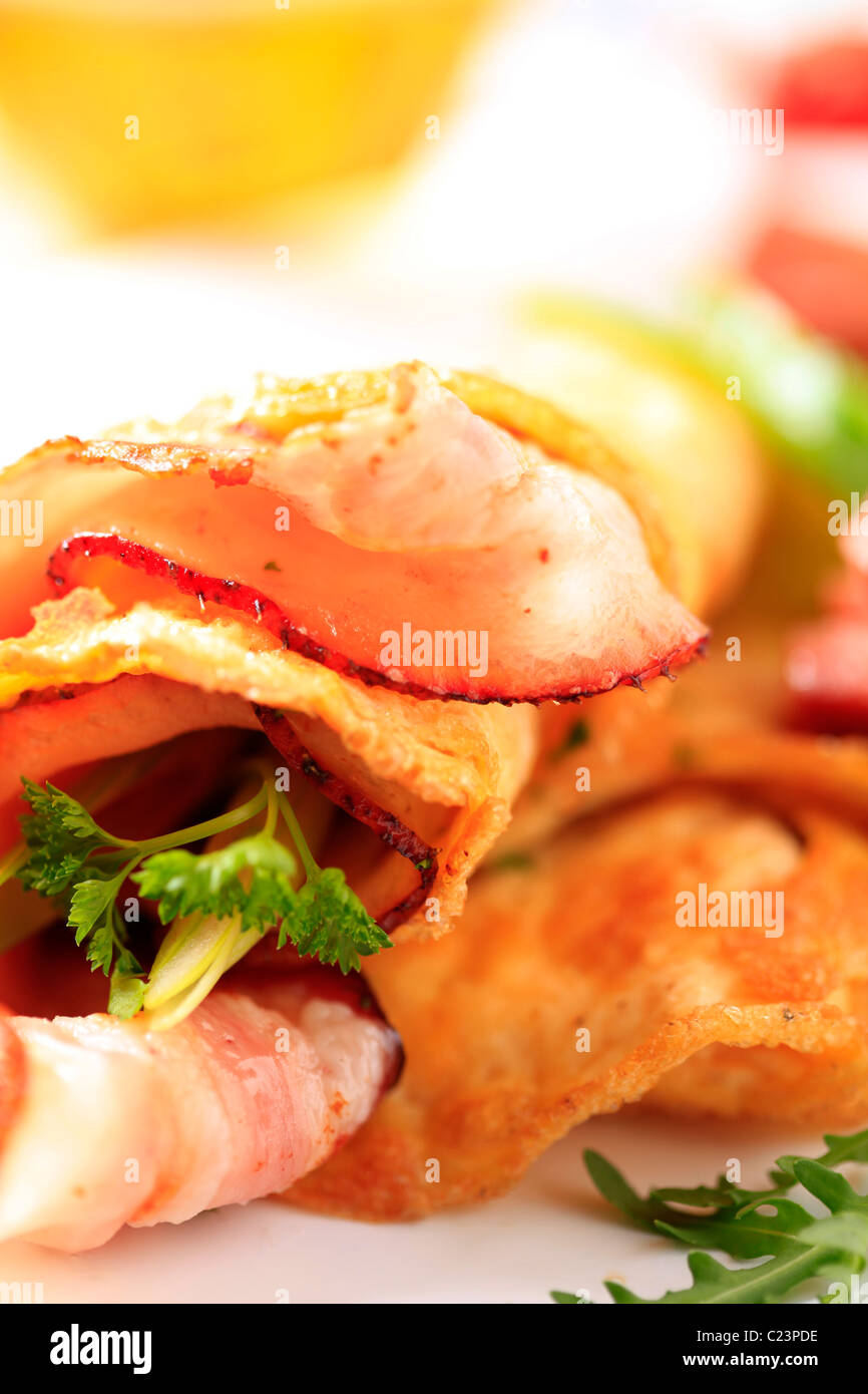 Fried egg omelet and bacon - detail - Stock Image