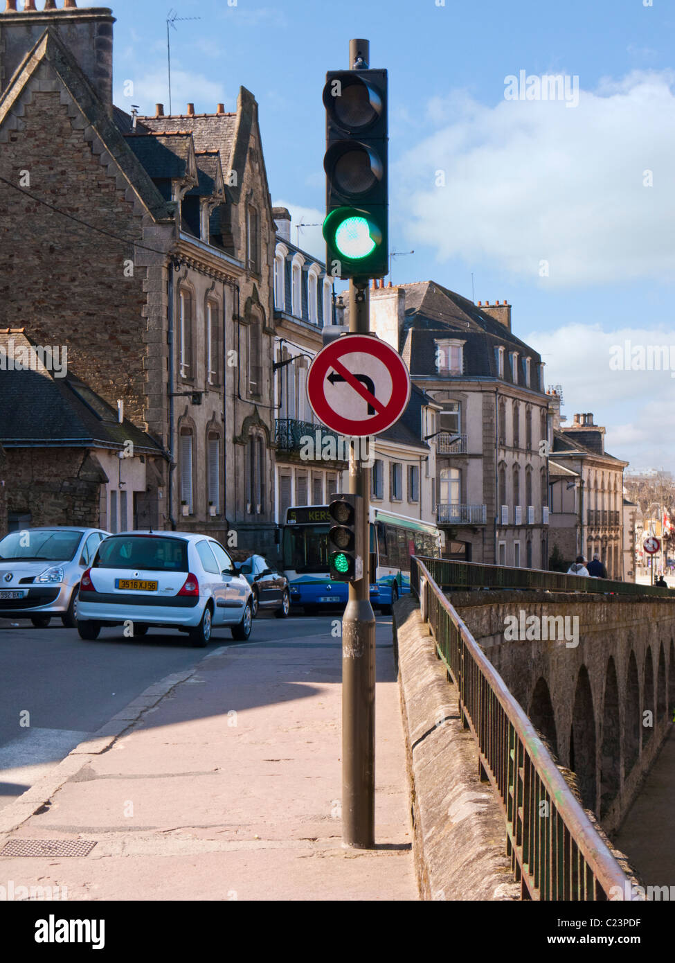 Traffic light signals on green France Europe - Stock Image