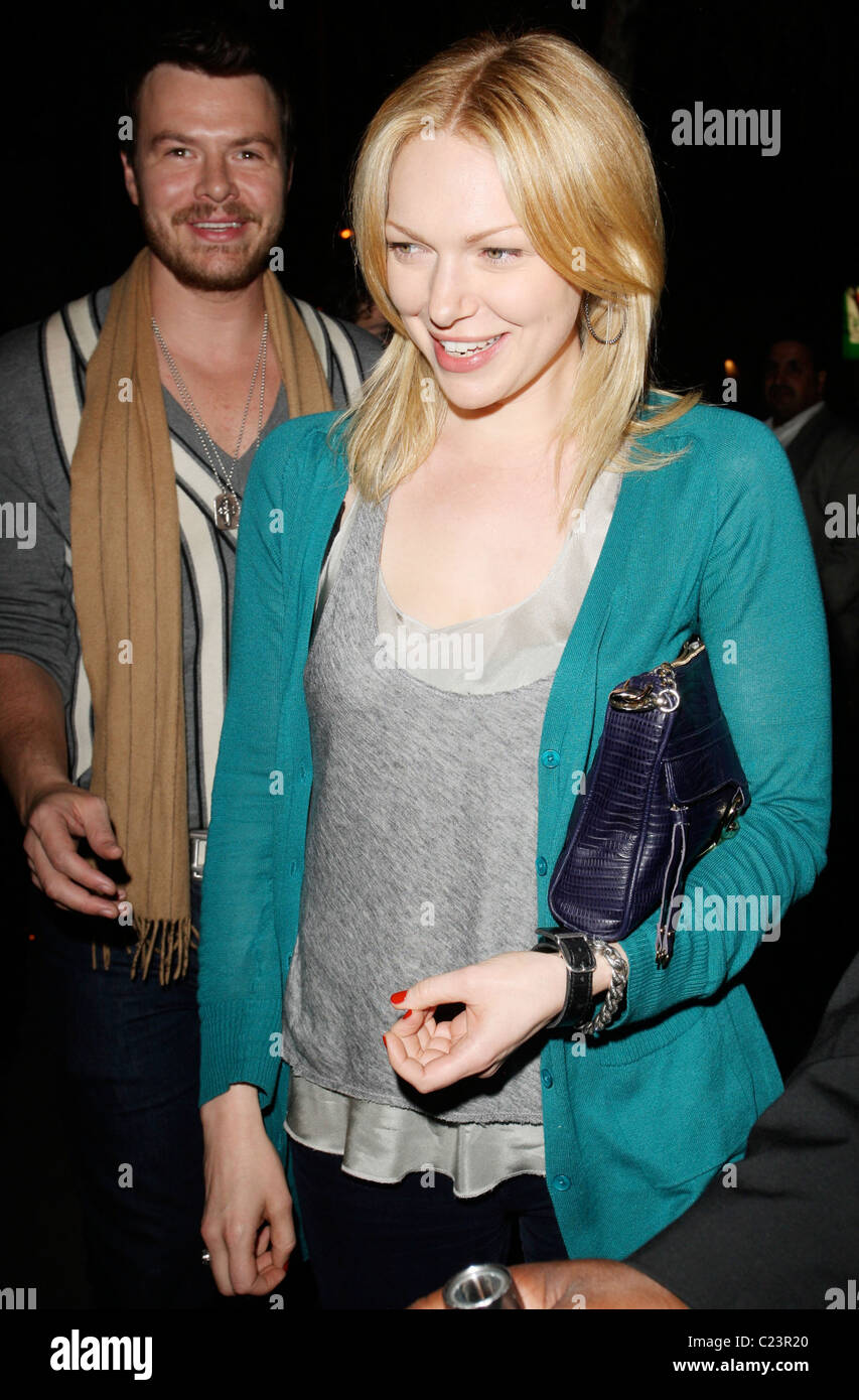 Laura Prepon and her boyfriend outside the Club Voyeur in West Stock