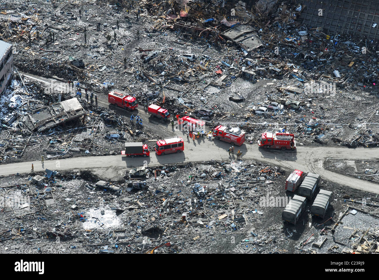 Japan (March 18, 2011) aerial view of Japanese Ground Self-Defense Force personnel and disaster relief crews searching - Stock Image