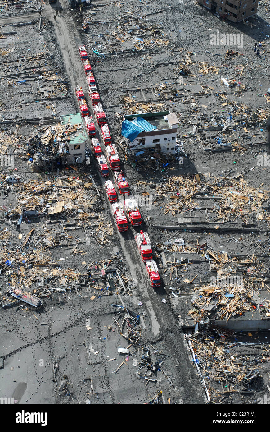 SUKUISO, Japan (March 18, 2011) Japanese fire trucks line a road in this aerial photo of Sukuiso, Japan after earthquake Stock Photo