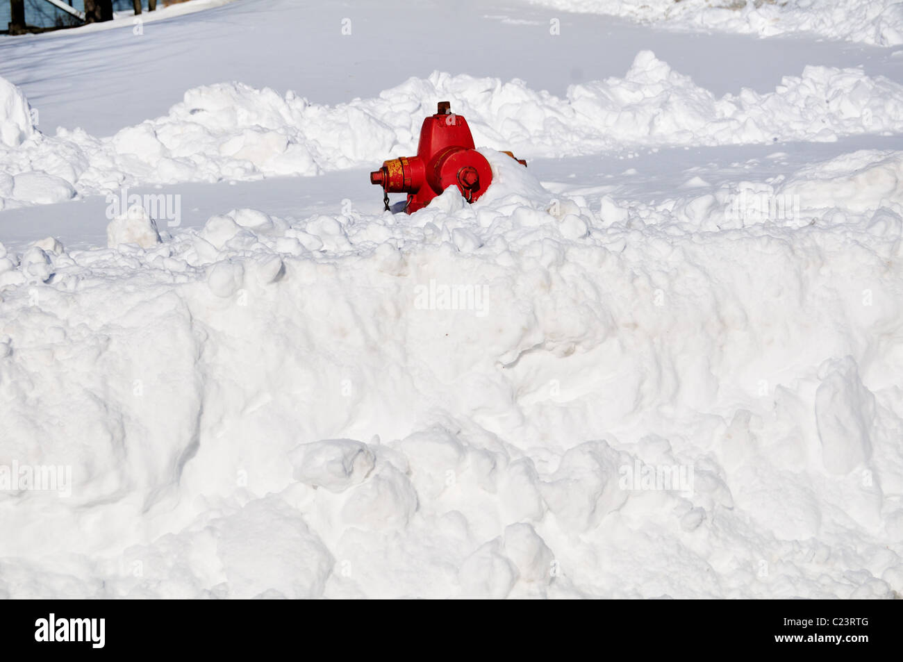 Midwestern blizzard dumped heavy snow fall buried fire hydrants which have to be located and dug out of snowdrifts - Stock Image