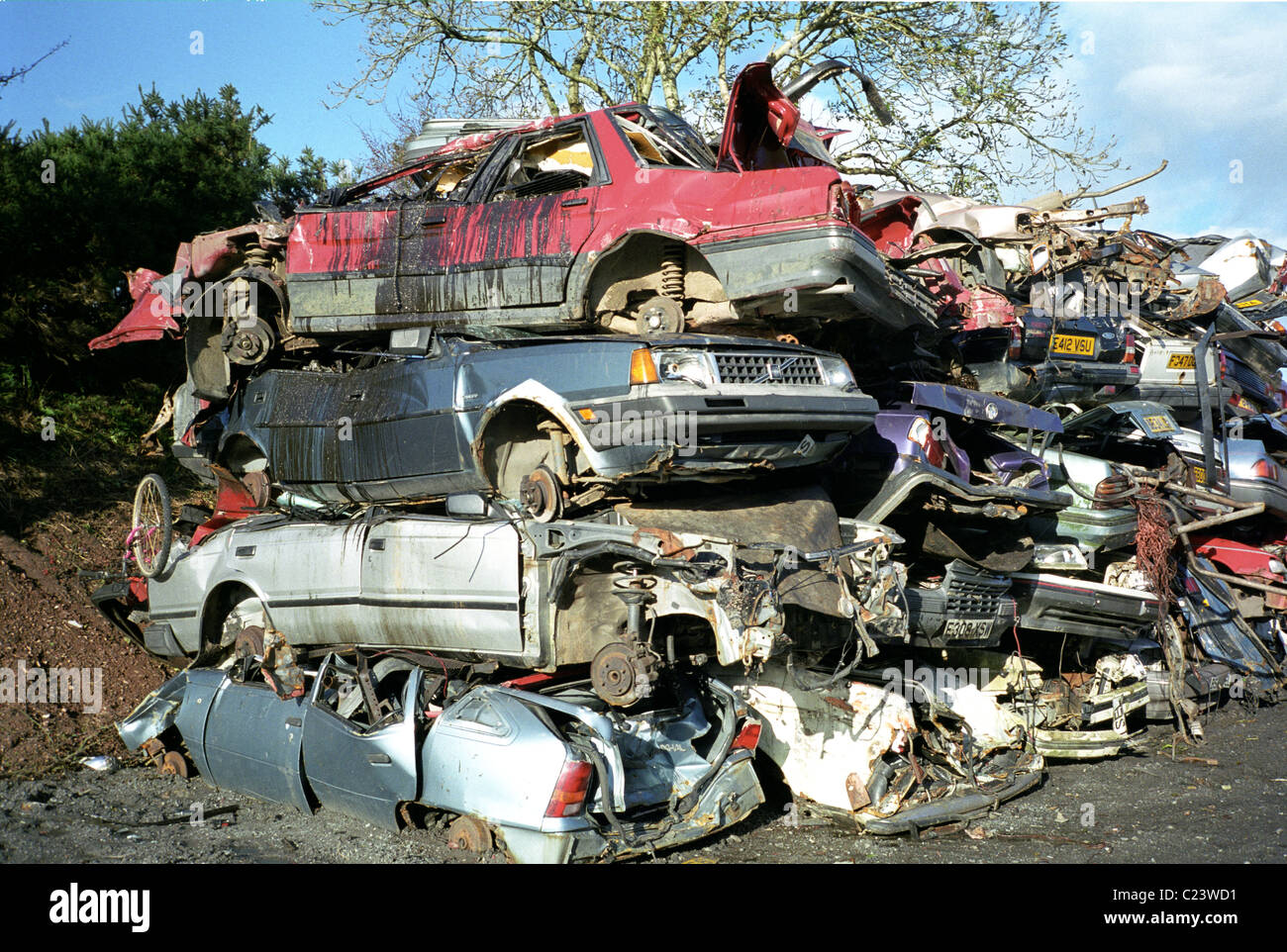 car wreckers yard with wrecked cars piled on top of each other Stock ...