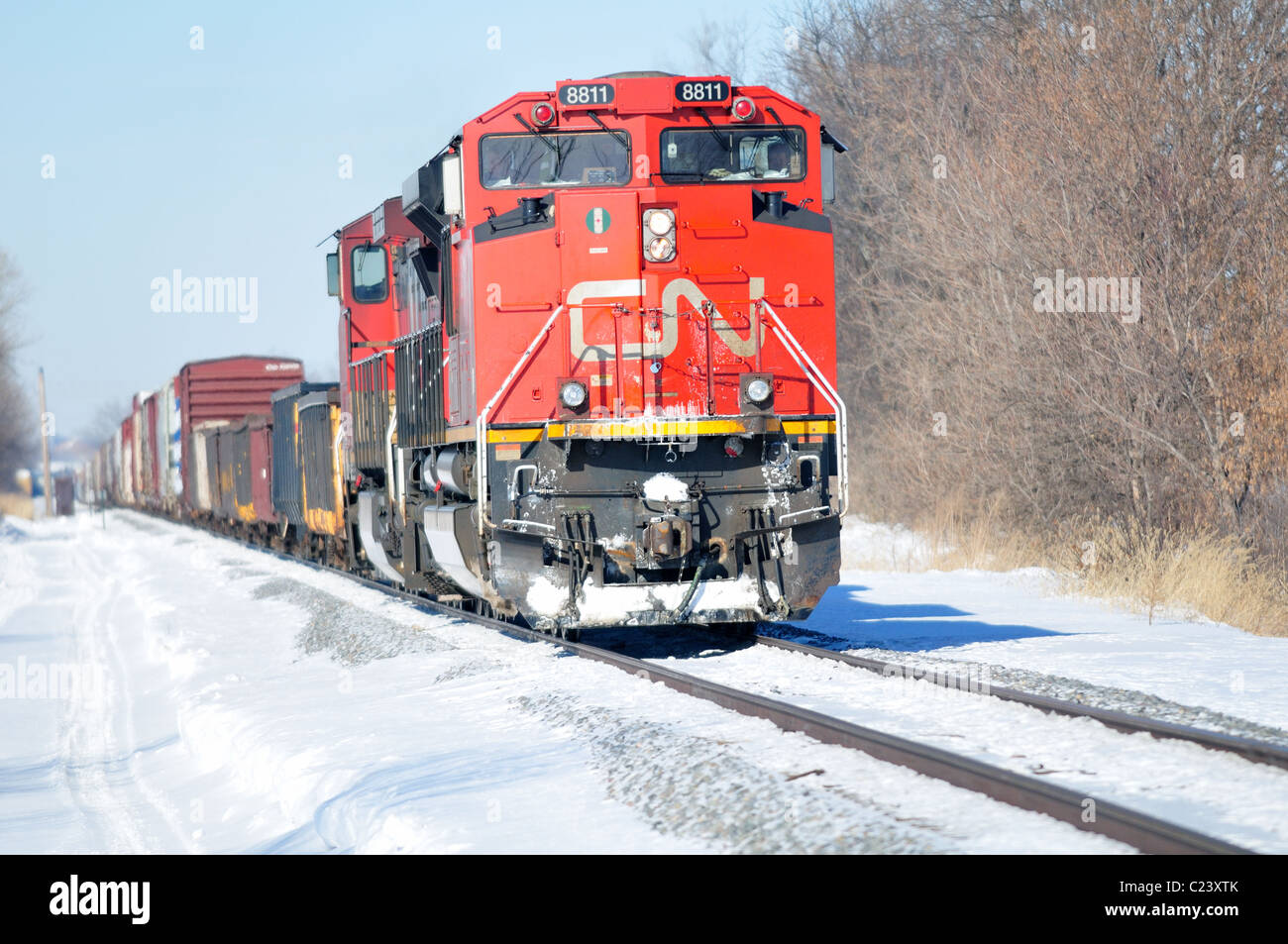 Unit 8811 heads up two Canadian National Railway locomotives on a cold winter day. Bartlett, Illinois, USA. - Stock Image