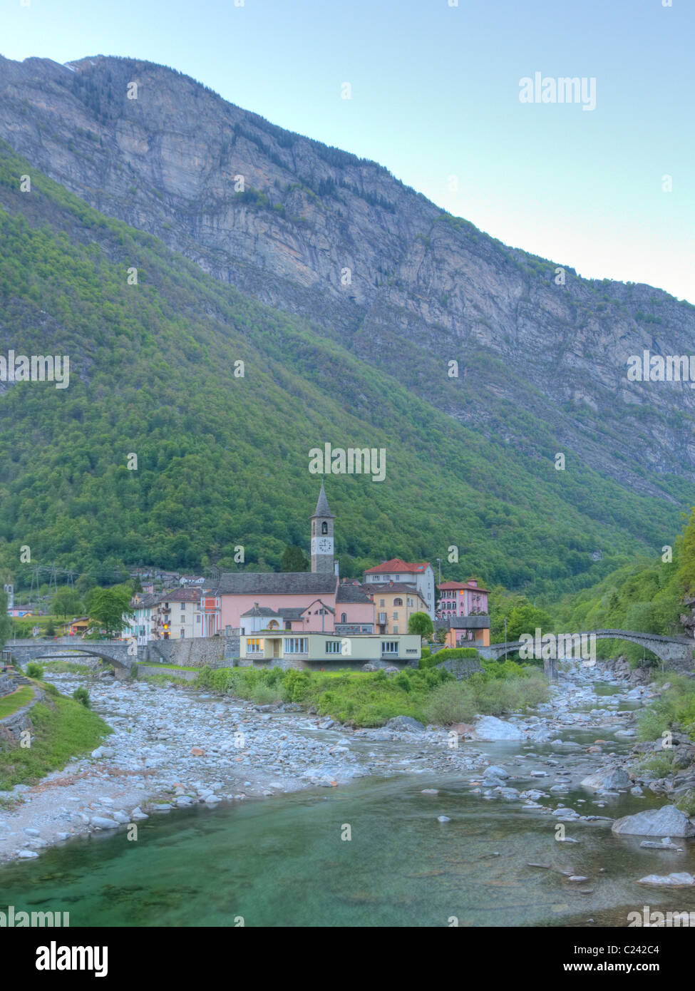 Small village of Bignascoin the evening with its two bridges situated in the upper valley of river Maggia in canton Stock Photo