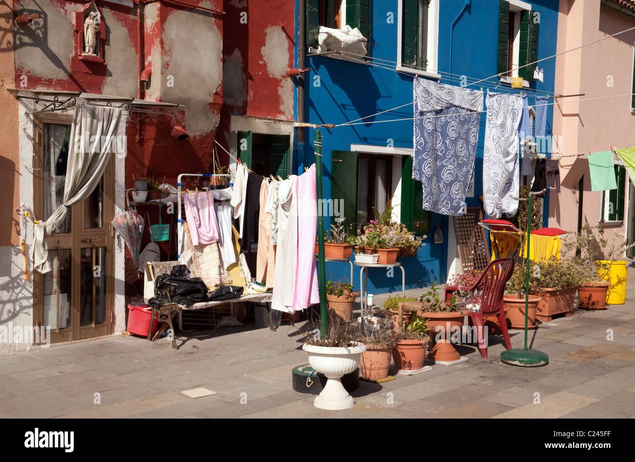 Typical Burano backyard with washing, Burano village, Venice, Italy - Stock Image