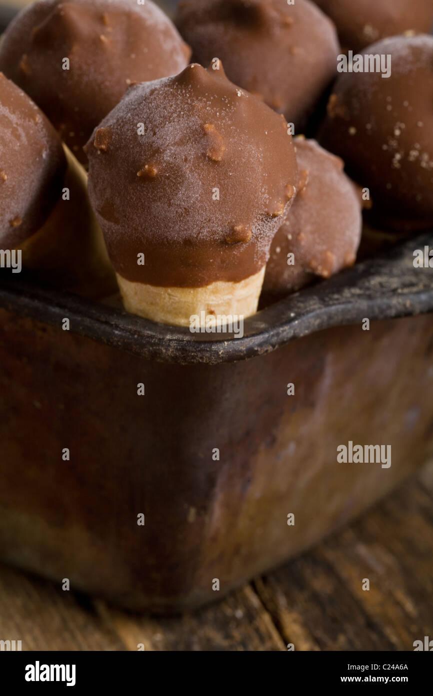 Mini ice cream cones in a tin - Stock Image