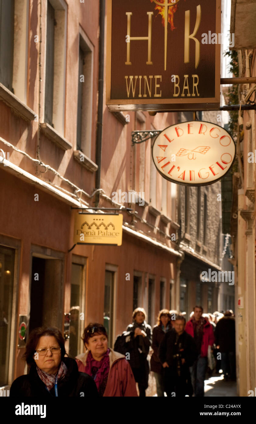 HK wine bar and people in a narrow street, Venice, Italy - Stock Image