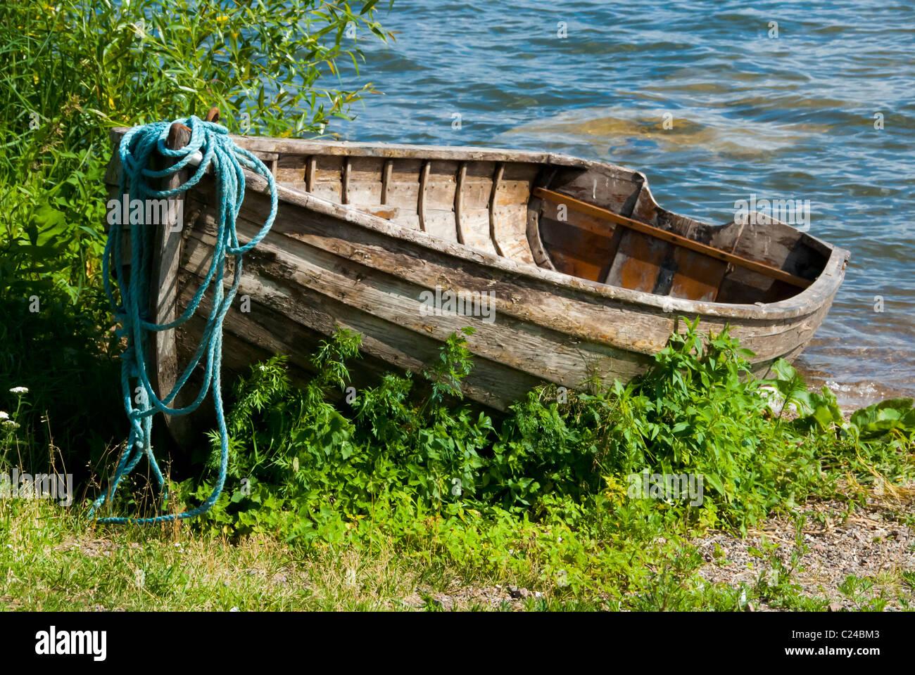 Old boat ashore Stock Photo