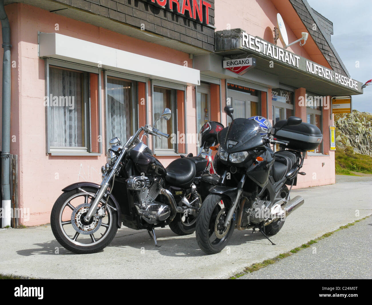 A Kawasaki VN-15 Chopper and Yamaha TDM900A motorcycle parked on the summit of the Nufenen Pass, Valais / Ticino, - Stock Image
