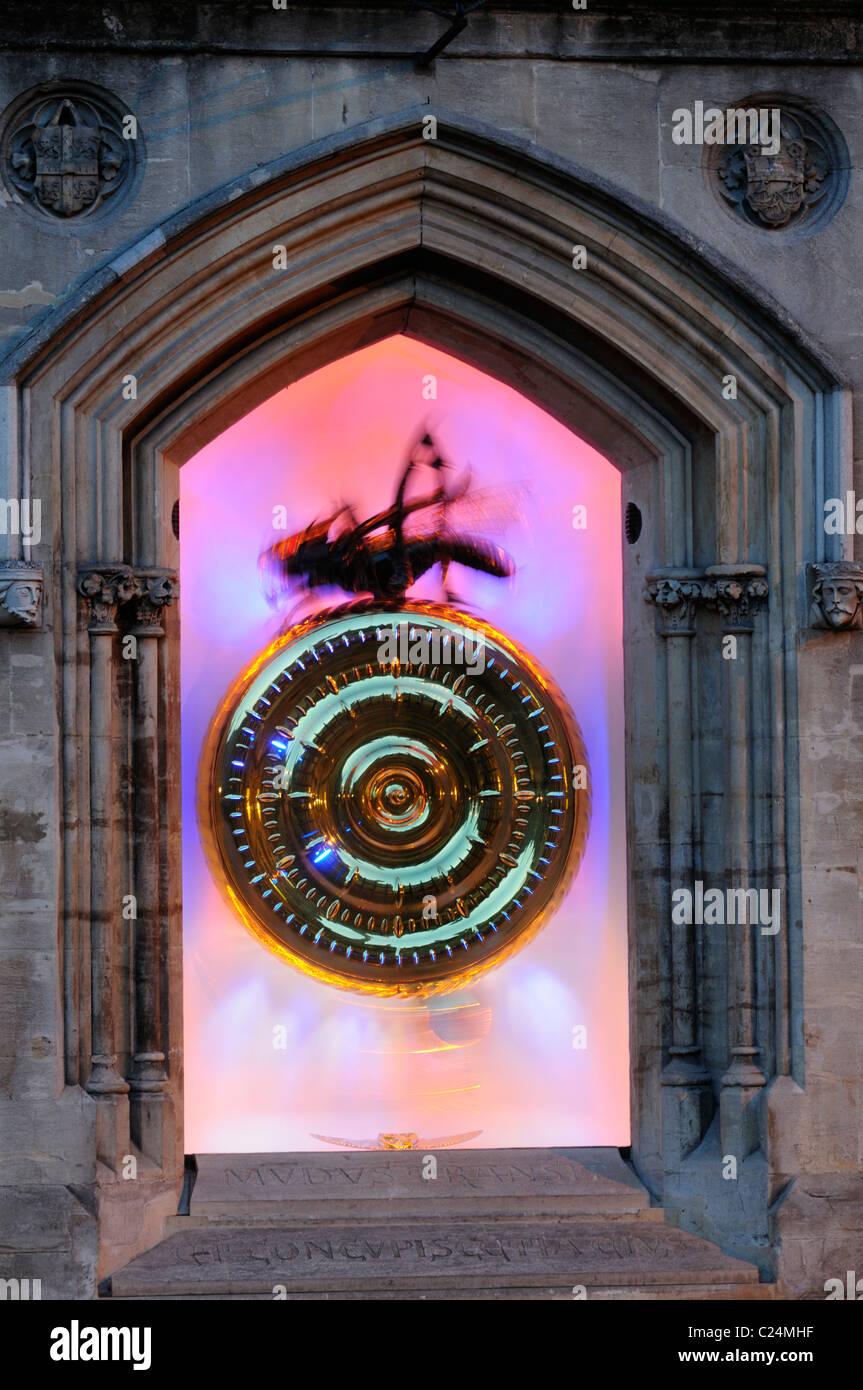 The Corpus Christi Clock Illuminated at dusk, King's Parade, Cambridge, England, UK - Stock Image