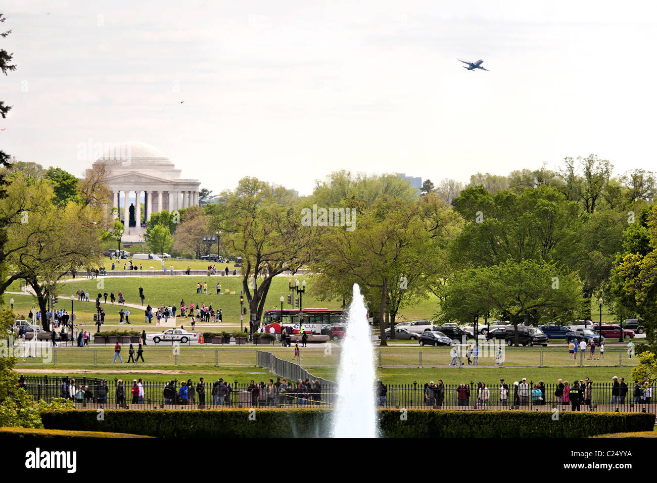 View from the White House towards Jefferson Memorial across The National Mall. A plane is approaching. Washington - Stock Image