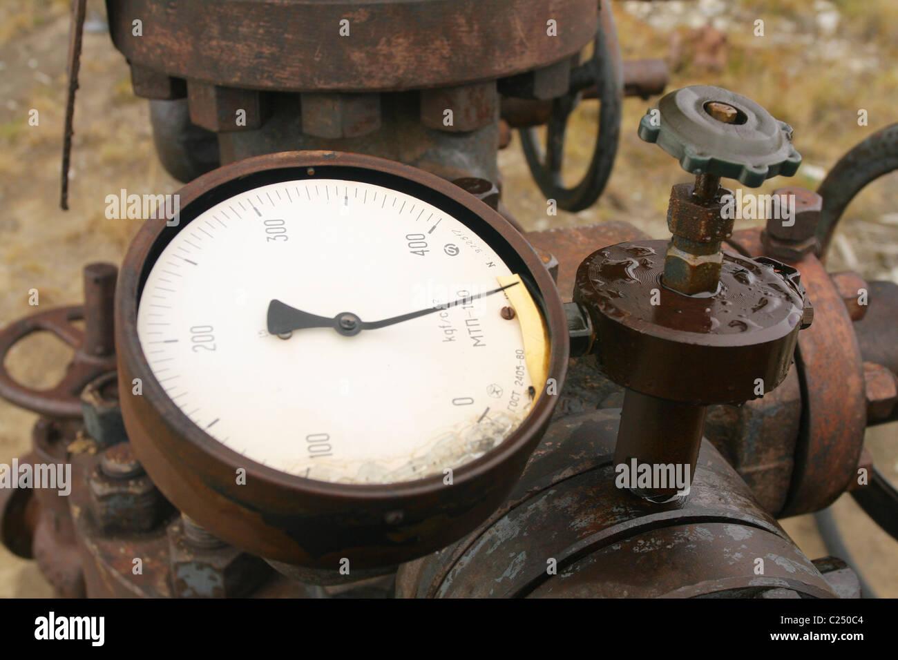 Broken manometer near casing head with gas-condensate leakage. Yamal peninsula, RUSSIA - Stock Image