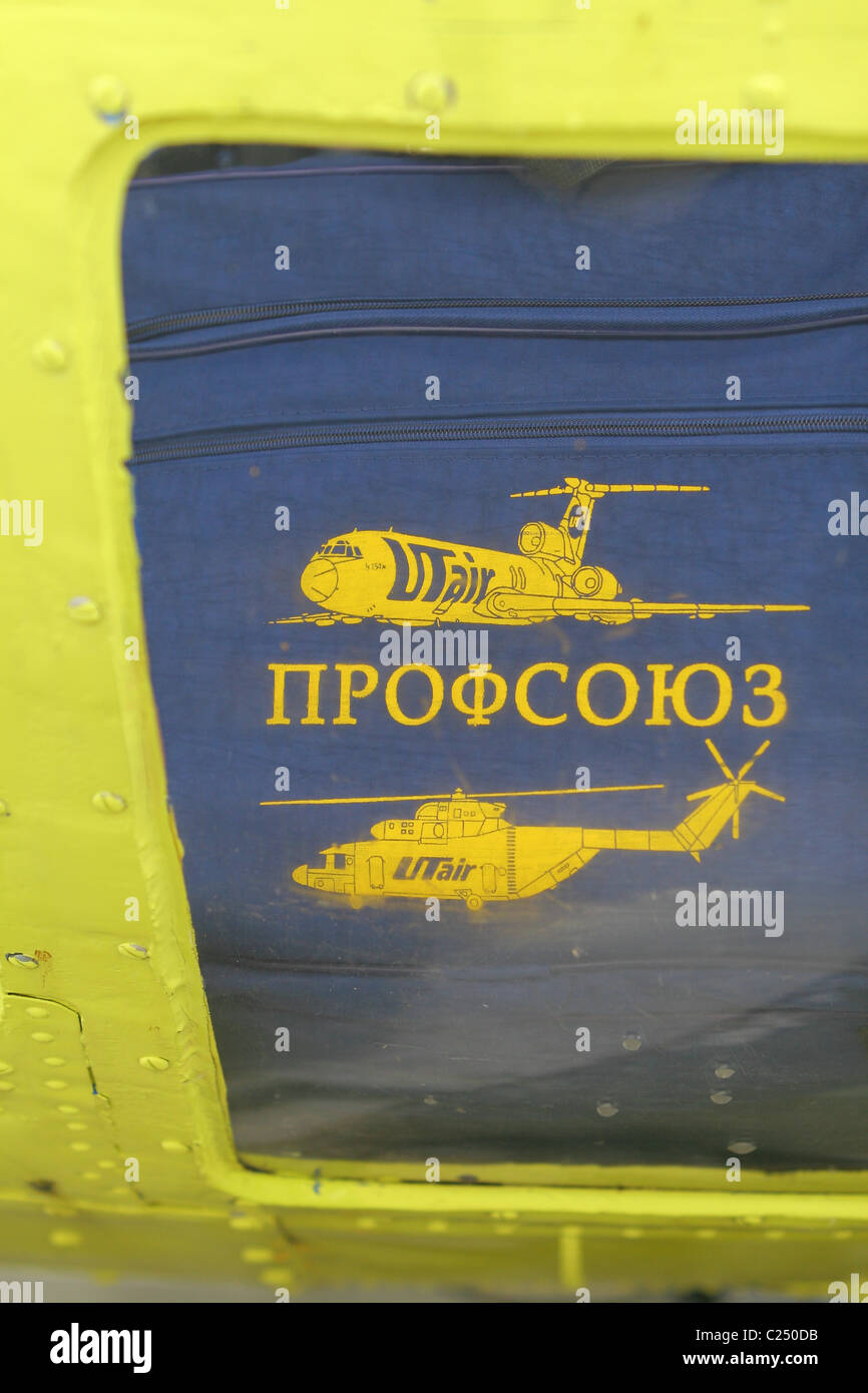 Handbag with the words 'trade union' (in Russian) is in the helicopter cockpit. Siberia, RUSSIA - Stock Image