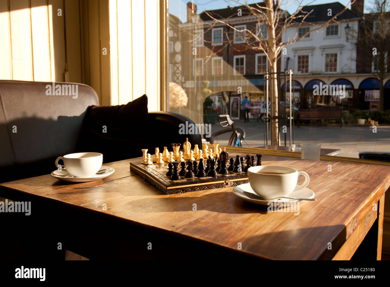 Attrayant Game Of Chess Set Out On A Coffee Table With Two Cups