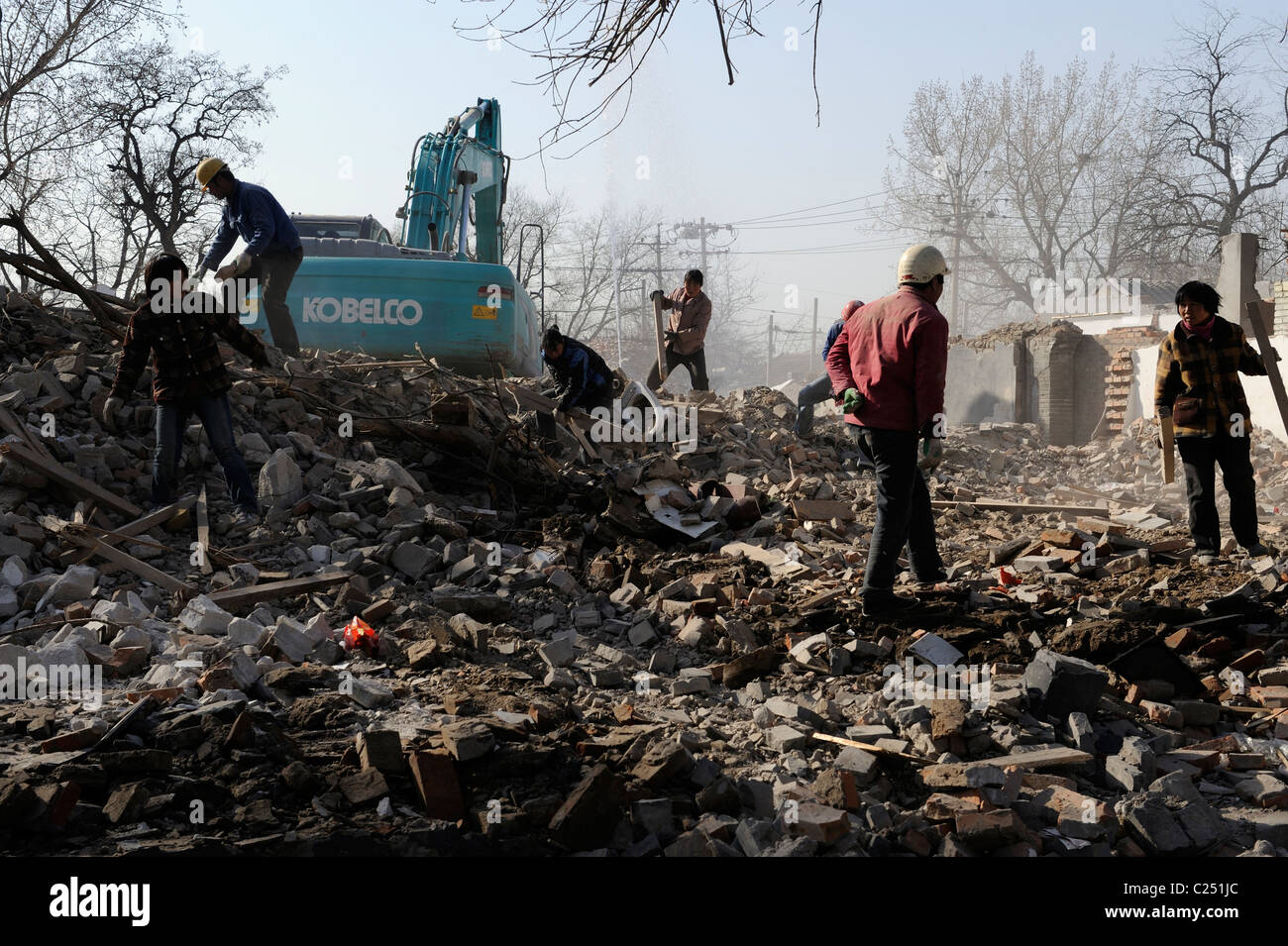 People collect recycle materials from ruins of demolished houses in central Beijing, China.20-Mar-2011 - Stock Image