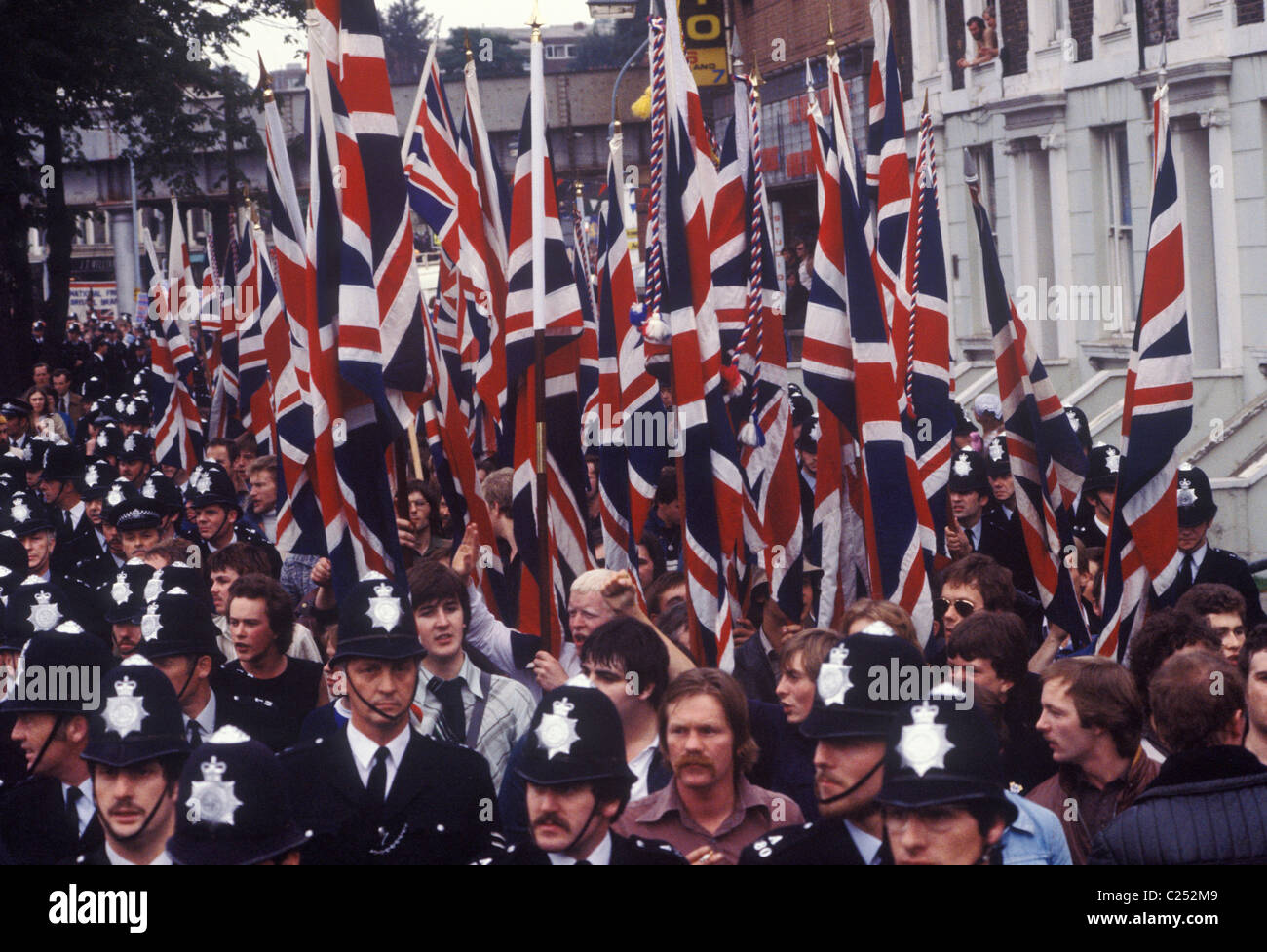 National Front march through Lewisham South London England 1977 The police protect the NF march from left winger - Stock Image