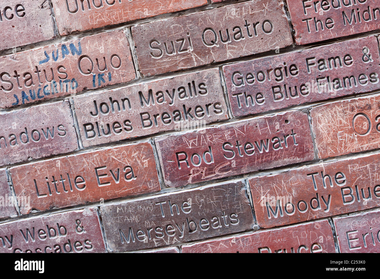 Brick wall with band names embossed, outside the famous Cavern Club, Liverpool - Stock Image
