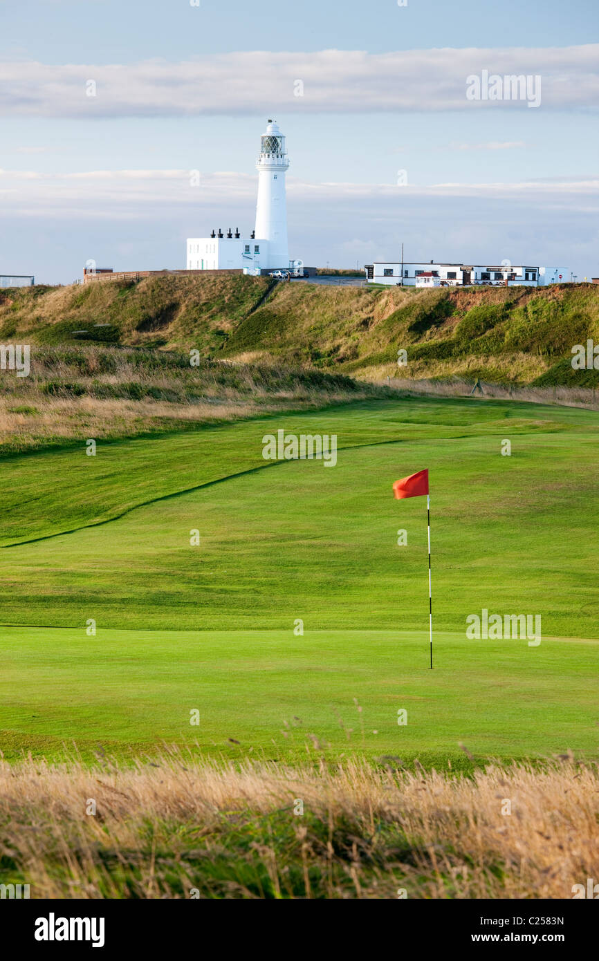 The lighthouse at Flamborough Head viewed across the golf course, Flamborough, East Yorkshire - Stock Image