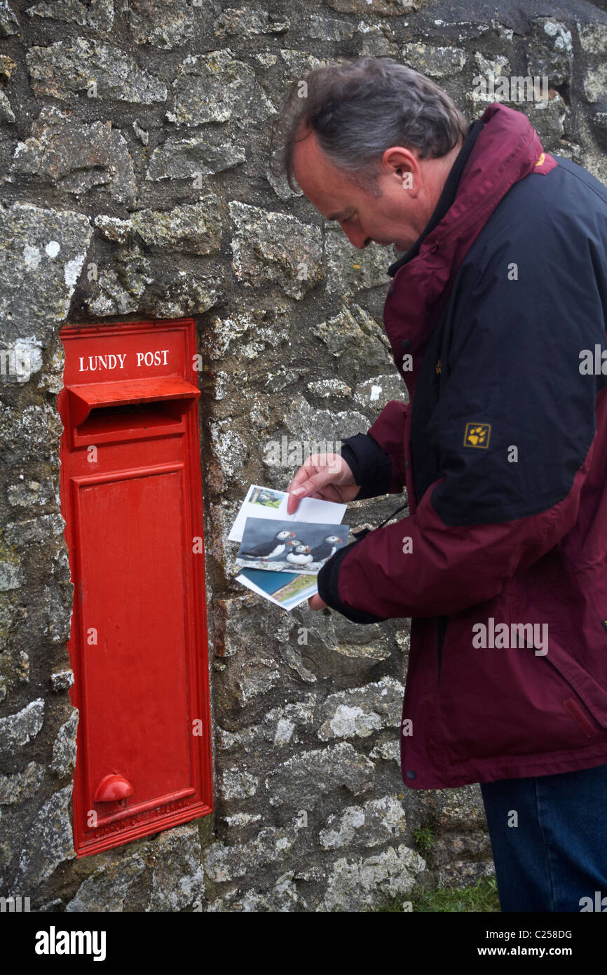 Man posting postcards on Lundy Island, Devon, England UK in March Stock Photo
