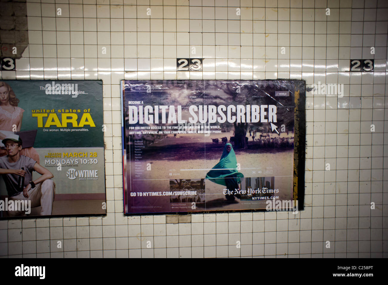 Advertising for the new subscription service of the New York Times digital is seen in the New York subway - Stock Image