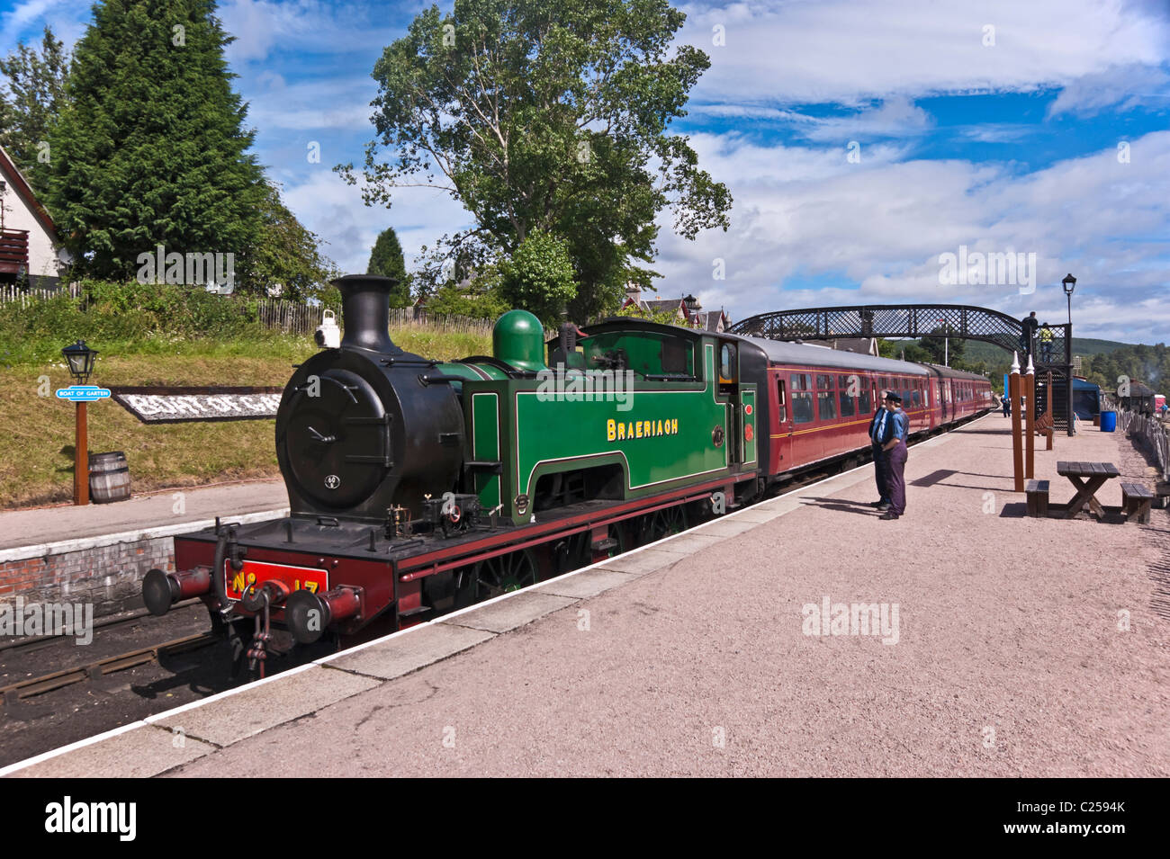 steam engine Braeriach standing at the platform on Boat of Garten railway station en route to Aviemore Stock Photo