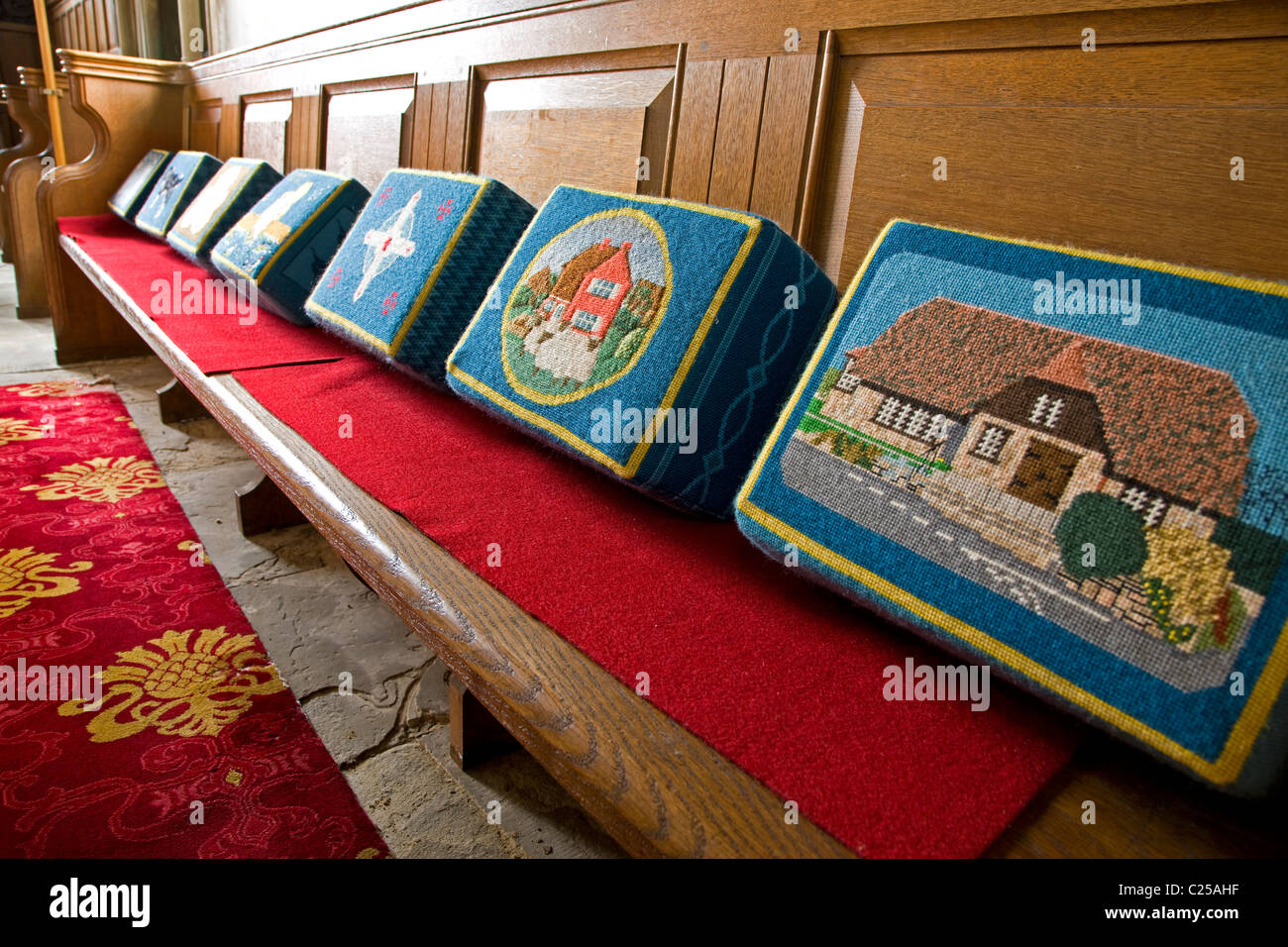 Embroidered tapestry kneelers in All Saints Church in Tealby - Stock Image