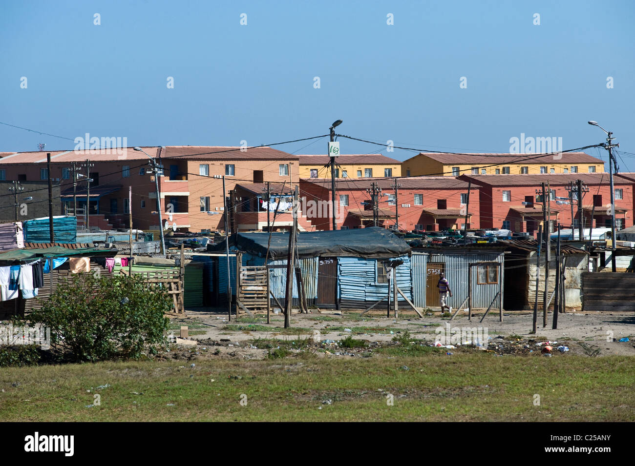 Shacks and new housing along Vanguard Drive, Epping, Cape Town, South Africa Stock Photo