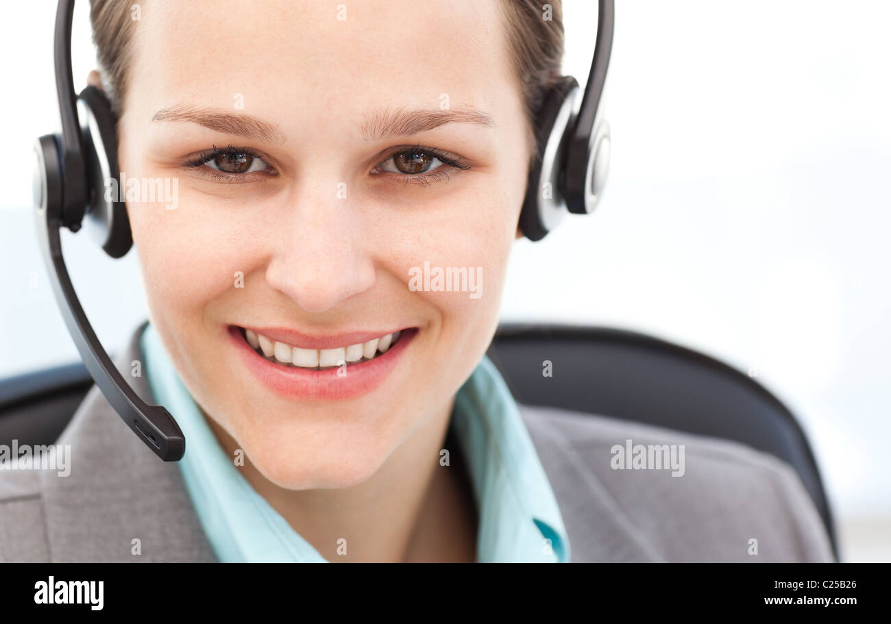 Portrait of a pretty operator with earpiece - Stock Image