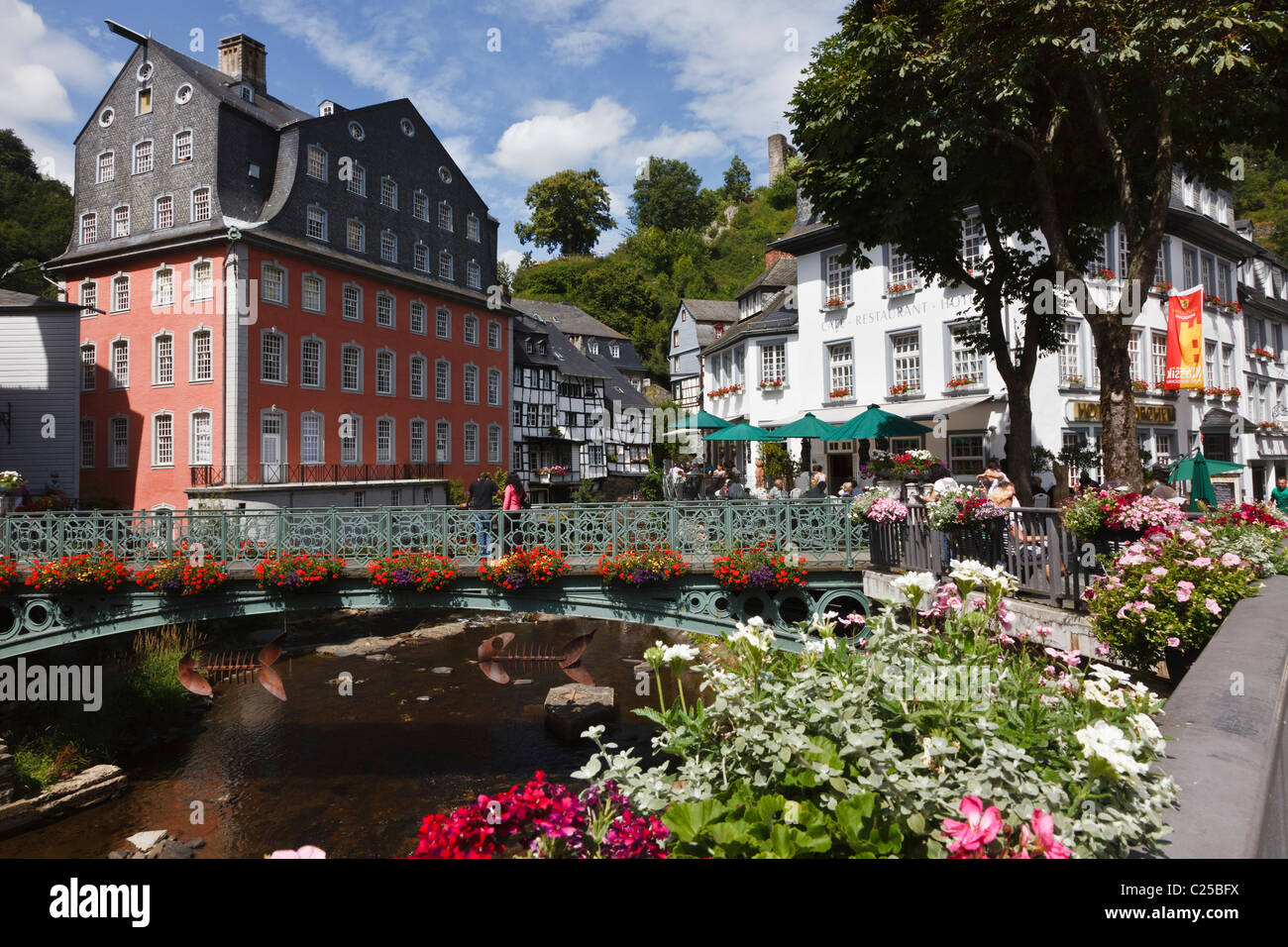 Bridge over the River Rur and the Rotes Haus (Red House) in the historic centre of Monschau, Germany. - Stock Image