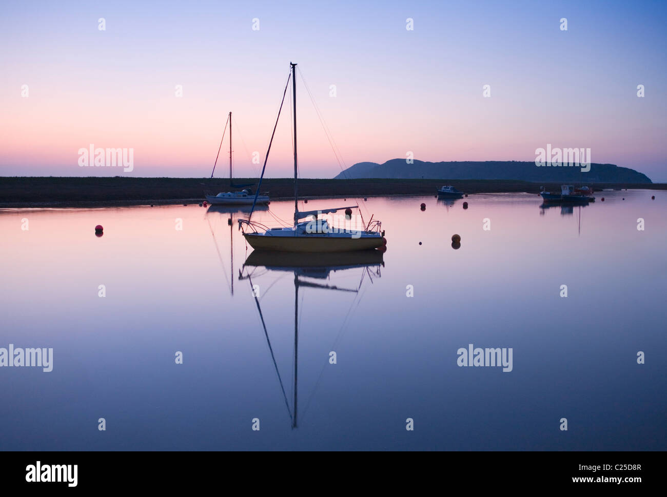 Boats Moored on the River Axe Estuary with Brean Down in the distance. Somerset. England. UK. Stock Photo