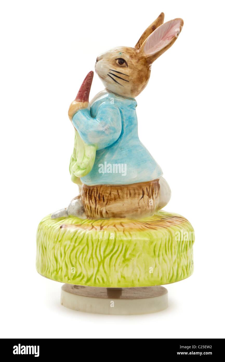 Peter Rabbit revolving ceramic figurine with musical movement - Stock Image