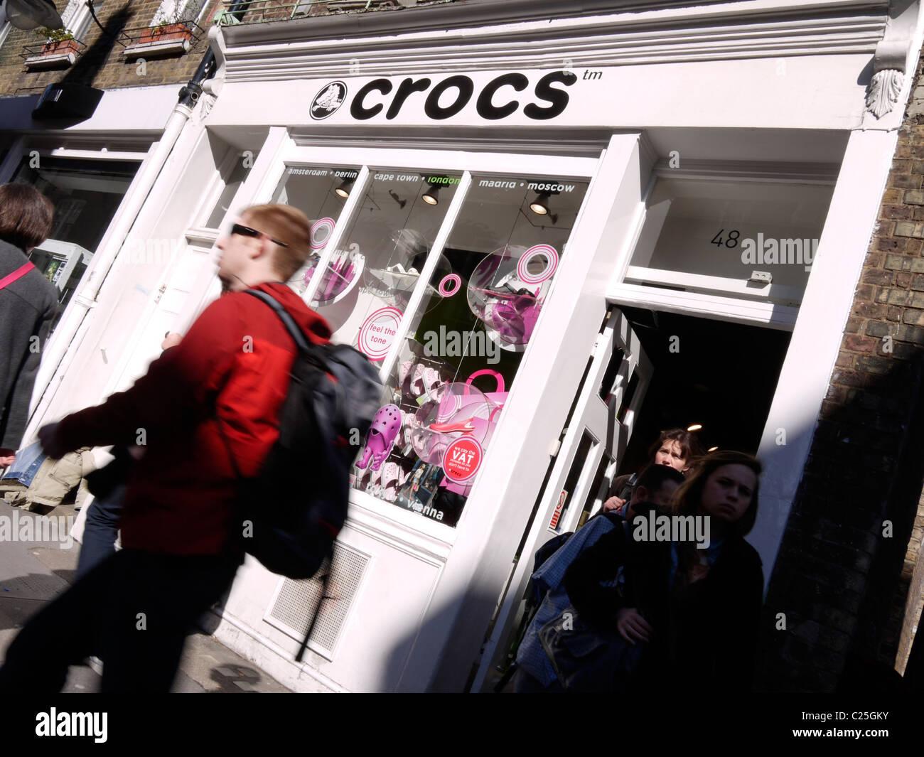 crocs retail shoe outlet, shoes - Stock Image