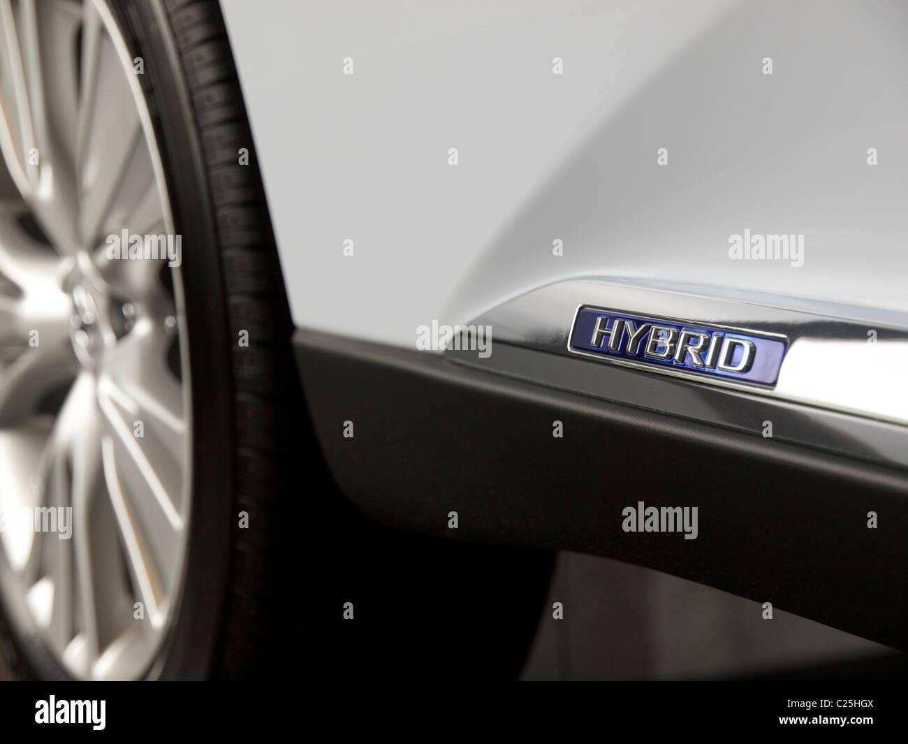 Hybrid logo on white Lexus RX450h SUV detail closeup - Stock Image