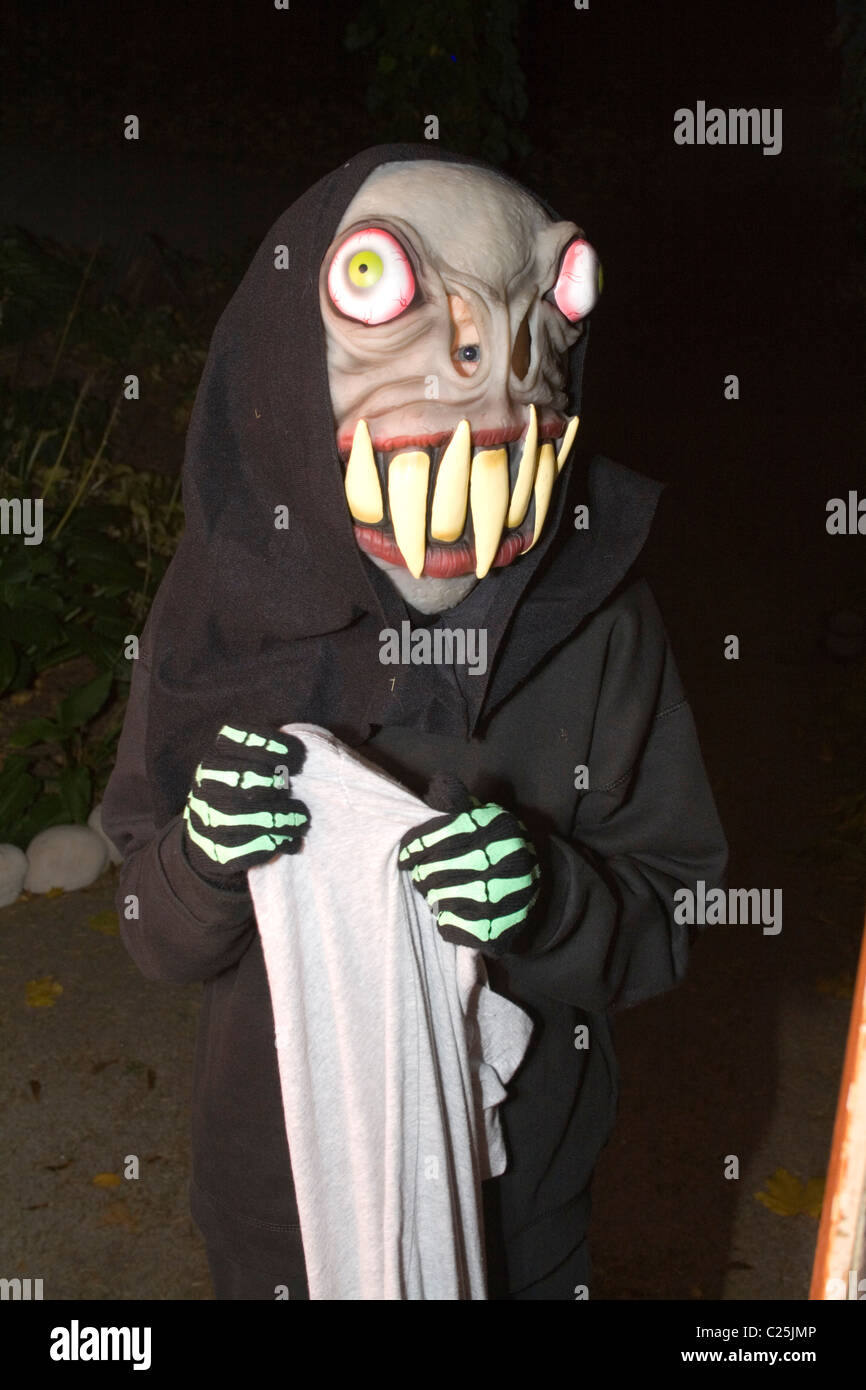 scary halloween ghoul with large teeth holding trick or treat candy bag st paul minnesota mn usa