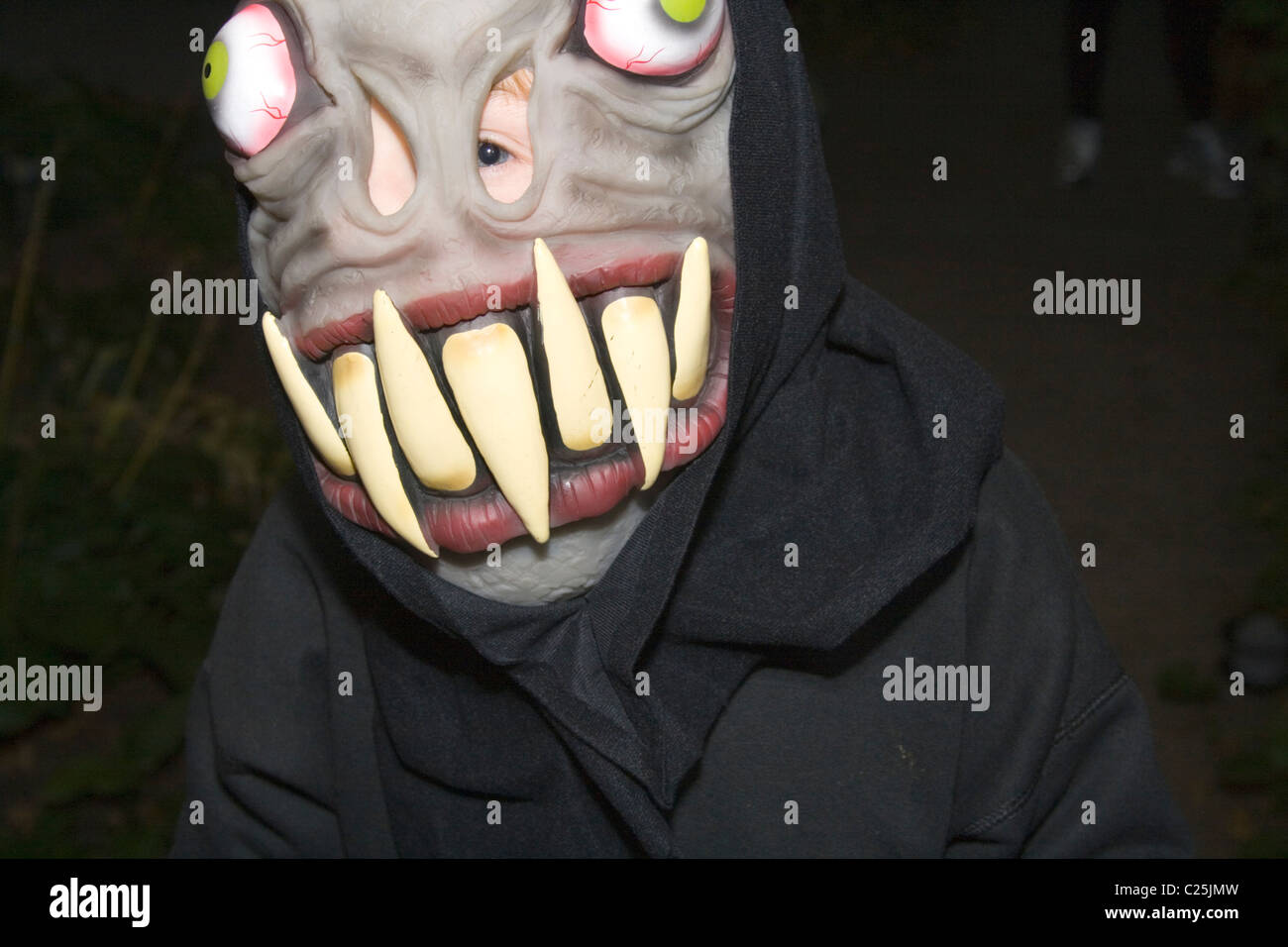 scary halloween ghoul with large teeth trick or treating in the neighborhood st paul minnesota mn usa