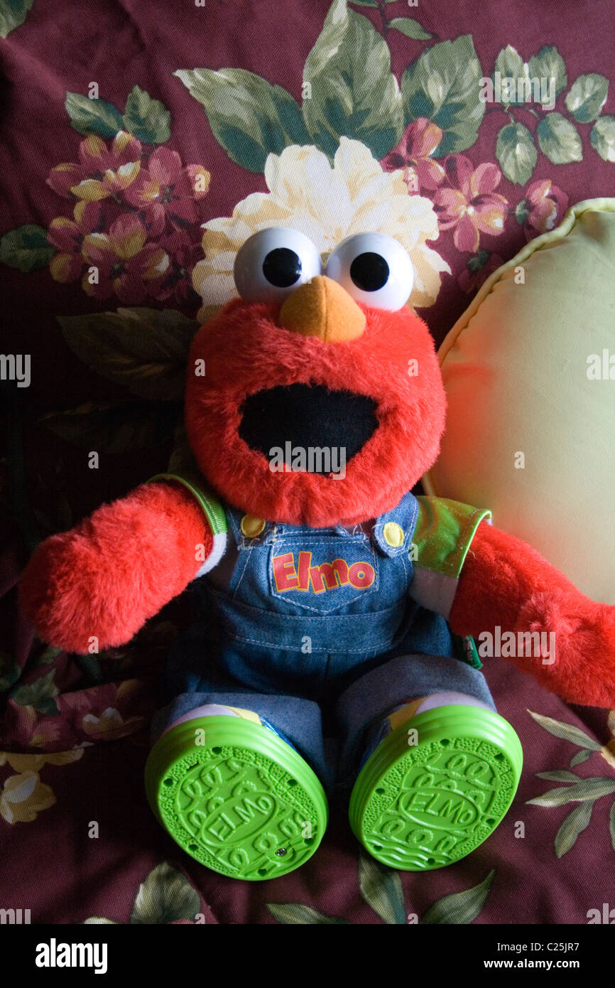 Tickle me Elmo toy doll dressed in his own Elmo bibs. Battle Lake Minnesota MN USA - Stock Image