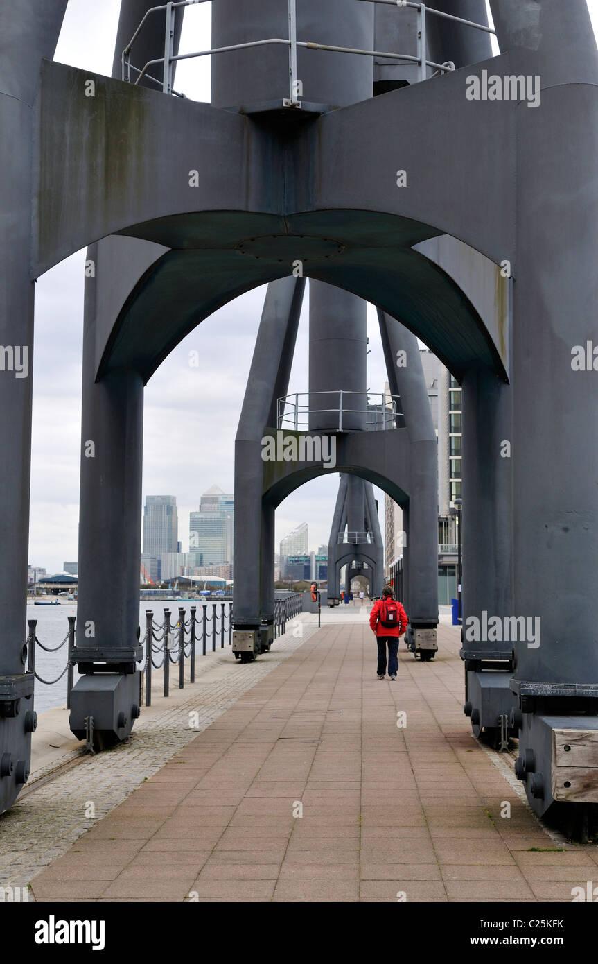 No longer used cargo cranes on quayside of Royal Victoria Docks, London - Stock Image