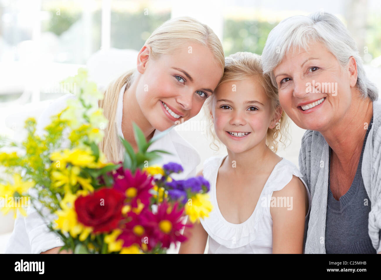 Radiant family with flowers - Stock Image